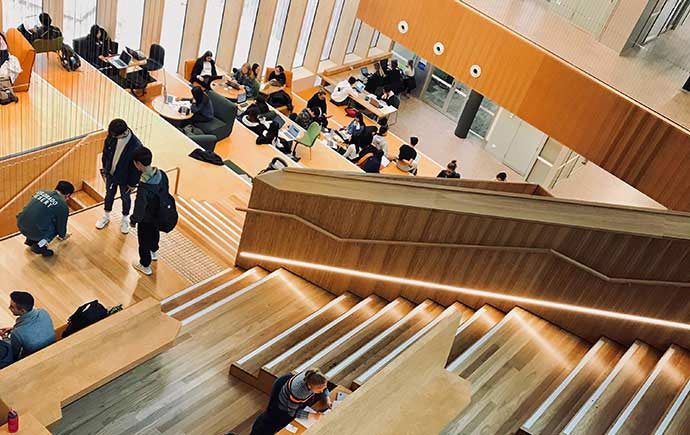 Students on Learning and Teaching Building staircase