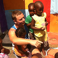 Tristan Vogrig helping paint a kindergarten in Zandspruit, South Africa.