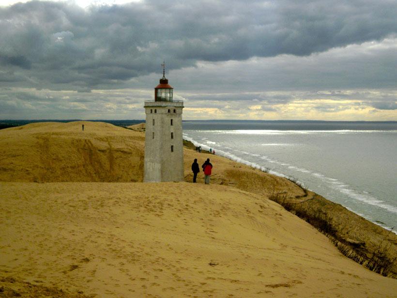 A lighthouse in the sand dunes, Denmark.