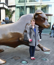 Laura Driessen with the bull statue in the Bullring shopping centre, Birmingham (UK)