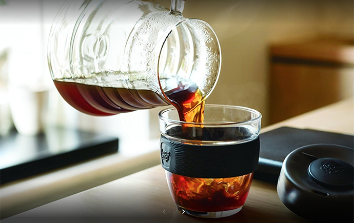 tea being poured into a cup