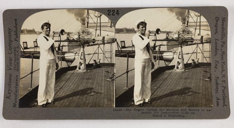 The bugler calling the Marines and sailors to assemble for instruction - Life on board a battleship
