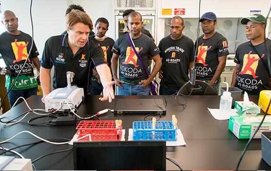Associate Professor Bayden Wood (centre) and his diagnostic tool.