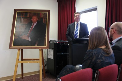 Professor Euan Wallace with portrait of Professor David L Healy.