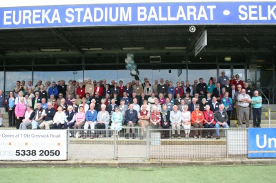 staff and participants from the Ballarat region take time out from their celebratory morning tea for a commemorative photo to mark the first 12 months of the trial.