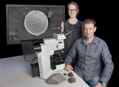 Dr Andrew Tomkins and Dr Sasha Wilson, Monash University, with an image of an Archean Micrometeorite Credit: Steven Morton
