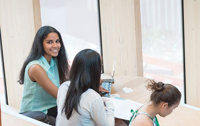 Smiling student looks at camera
